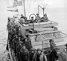Soldiers crowded on the deck deck of a Motor Torpedo Boat