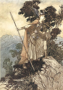 A youthful valkyrie, wearing armour, cloak and winged helmet and holding a spear, stands with one foot on a rock and looks intently towards the right foreground. In the background are trees and mountains.