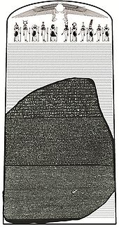 """""""Image of the Rosetta Stone set against a reconstructed image of the original stele it came from, showing 14 missing lines of hieroglyphic text and a group of Egyptian deities and symbols at the top"""""""