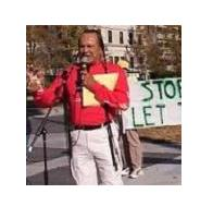 Russell Means speaks against the War on Terror at a DC Anti-War Network's anti-war protest on November 11, 2001.