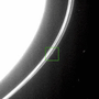 A segment of the ring with bright overexposed Saturn in the top-left corner. Near the right edge of the ring there is a bright dot.