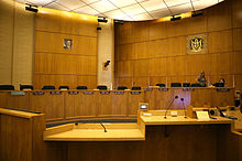 Wood paneling floor to ceiling with seats for 8 members and support staff