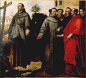 Man in his twenties or thirties standing transfixed in front of a cross his height, five onlookers