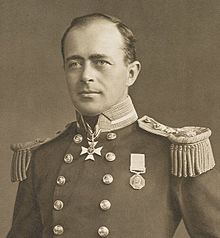 Man with receding hairline, looking left, wearing naval uniform with medals, polished buttons and large epaulettes