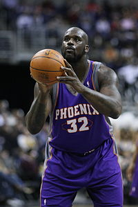 Shaquille O'Neal is taking a free throw while playig for the Phoenix Suns.