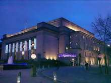 Sheffield City Hall, a Neo-classical design with a large portico and prominent pillars which were damaged when a bomb fell on the adjoining Barkers Pool during World War II. It is a grade II* listed building