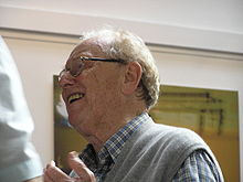 left profile (head and shoulders) of elderly man in animated discussion