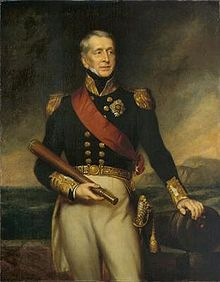 Three quarter-length portrait of a man, wearing a dark blue jacket with epaulettes and gold buttons, and white trousers. His left hand rests on a cannon, while he holds a telescope in his right