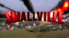 "The word ""SMALLVILLE"" appears in red, block letters in front of a background of a small town as a meteor shower occurs."
