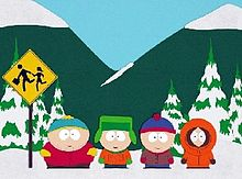 Screenshot from an animated show: Against a background of snowy mountains and trees, four boys stand and wait at a school bus stop