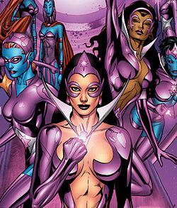 A cartoon image of four super heroines wearing glossy, violet costumes. The woman on the far left is wearing a small mask and has blue skin. The woman centered, standing in front of the rest, has long hair, a provocatively low cut costume, and wearing a glowing violet ring that she is holding up at chest height. The woman immediately to the right of her is wearing a similar costume and is flying upward. The woman on the far right is flying toward the viewer, has blue skin, and no nose.