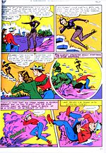 "A page taken from All-Flash Comics #32, showing the Flash and a woman in a coat standing on an alien planet with a yellow sky and violet sand. They are watching a woman in a violet costume escape up a floating stairway she&squot;s made using her super powers, and she tells the two they only have two minutes to live unless a device is reached in time. Flash tries to follow her using his super speed but falls to the ground with ""stunning force"" because speed is reversed on this planet."
