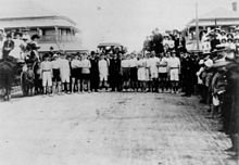 Racers and spectators at a starting line
