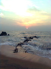 Cloudy sunrise at a rocky beach