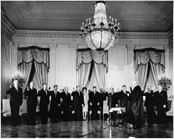The Cabinet is sworn in by Chief Justice Earl Warren on January 21, 1961.