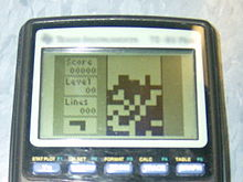 The game Tetris is being played on a TI-83 Plus.