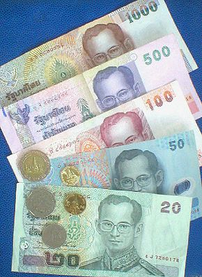Baht banknotes and coins