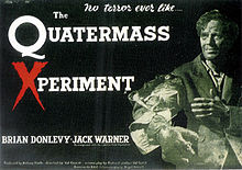 "A black and white photograph, tinted green, of a man, standing to the right, against a black background. His eyes are sunken into a gaunt face and he is holding out his right arm, which is horribly deformed. Left and centre is the film&squot;s tagline and title: ""No terror ever like…"" and ""The Quatermass Xperiment"" in white lettering, except for the &squot;X&squot; in &squot;Xperiment&squot;, which is in red. Below, in white lettering, are the names of Brian Donlevy and Jack Warner, the film&squot;s top-billed stars."
