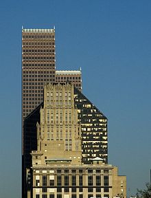 Three skyscrapers visually overlap each other. The simple, rectangular tiers of JPMorgan Chase Building contrast with the five-sided tower of the Pennzoil building and the stepped  rows of spires of the Bank of America building.