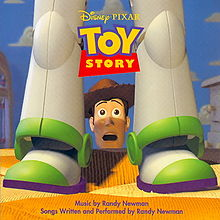 At the center of the album cover is a toy cowboy's head overlooking a bed with a shocked expression on his face. Sitting on the bed in front of him are the legs of a toy astronaut. The title of the soundtrack is at the top of the image and the production credits are located at the bottom.