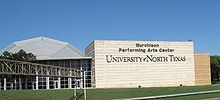 """Large building with the words """"Murchison Performing Arts Center University of North Texas"""" displayed in large letters."""