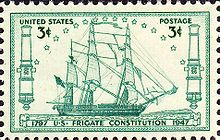 A postage stamp depicts Constitution at sail. The ship sails to the right side of the stamp.