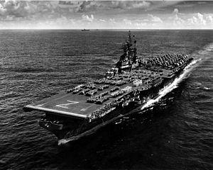 USS Shangri-La underway, with crew on parade.
