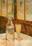 A table in a cafe with a bottle half filled with a clear liquid and a filled drinking glass of clear liquid