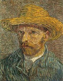 A mid to late 30s man gazing to the left with a green coat, gray tie and wearing a straw hat