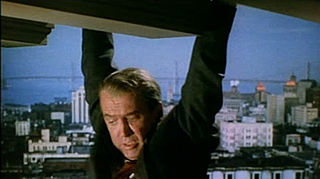 Vertigo 1958 trailer Stewart hanging on.jpg