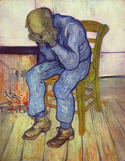A picture of an old man sitting alone on a straw chair with his head in his hands, evoking intense sorrow.