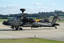 Attack helicopter taxiing on tarmac.