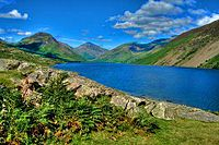 Blue lake between green hills.