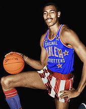Wilt Chamberlain holding a basketball