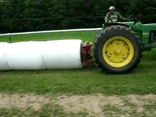 High Moisture Round Bale - Sealing Bales Together 320k.ogg