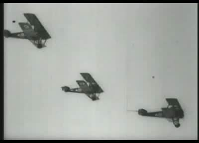 """World War I era biplanes on bombing runs, captioned """"Captain &squot;Eddie&squot; Rickenbacker, American &squot;Ace of Aces,&squot; over the lines– looking for a scrap."""" then """"Bombing the German lines."""""""